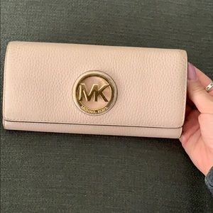 Michael Kors light pink and gold envelope wallet